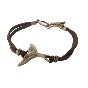 Brown faux suede bracelet with a gold tone whale tail and a toggle closure.