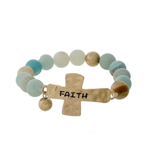 "Amazonite beaded stretch bracelet with a gold tone cross, stamped with ""Faith."""