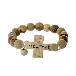 "Picture jasper beaded stretch bracelet with a gold tone cross, stamped with ""Believe."""