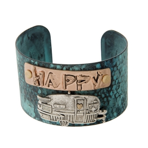"""Hammered patina cuff bracelet with """"Happy Camper"""" in two tone. Cuff measures approximately 1.5"""" in width."""