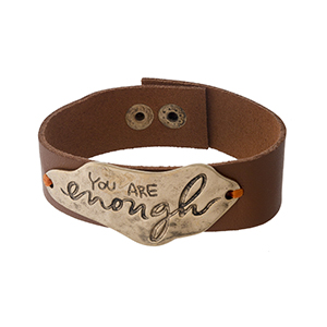 """Camel brown faux leather snap bracelet with a gold tone focal stamped with """"You Are Enough."""" Approximately 1"""" in width."""