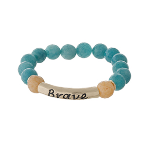 "Teal natural stone beaded stretch bracelet with a gold tone bar stamped with ""Brave."""