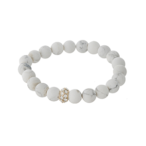 Howlite beaded stretch bracelet with a gold tone pave accent bead. Stones are approximately 10mm in size.