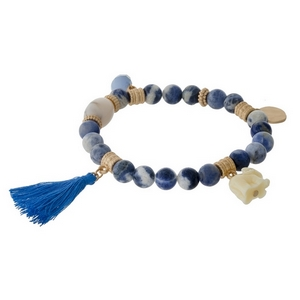 Sodalite natural stone beaded stretch bracelet with a blue tassel, gold tone accents and an elephant charm.