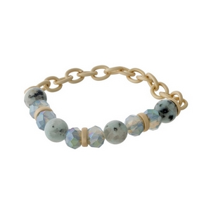 Matte gold tone stretch bracelet with sesame jasper natural stone beads and blue opal faceted beads.