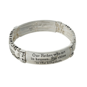 Silver tone stretch bracelet stamped with the Lord's Prayer.