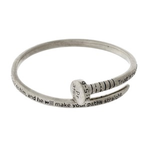 Silver tone bangle bracelet in the shape of a nail, stamped with Proverbs 3:5-6.