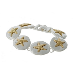 Silver tone magnetic bracelet featuring gold tone starfish.