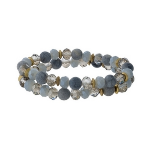 Gray natural stone and faceted bead stretch bracelet set with gold tone accents.