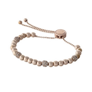 Dainty rose gold tone beaded pull-tie bracelet with clear rhinestone accents.