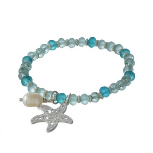 Turquoise and mint beaded stretch bracelet with silver tone accents and a filigree starfish charm.
