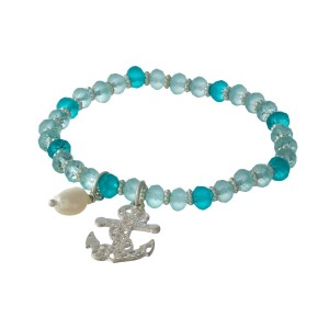 Turquoise and mint beaded stretch bracelet with silver tone accents and a filigree anchor charm.