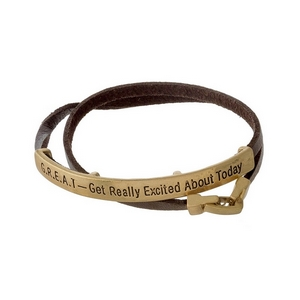 "Brown faux leather wrap bracelet featuring a gold tone bar, stamped with ""GREAT - Get Really Excited About Today."""