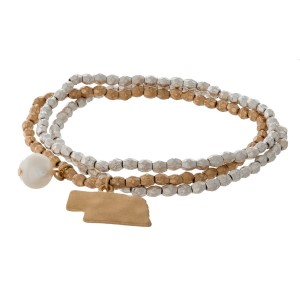 Two tone stretch bracelet with a state of Nebraska and freshwater pearl bead charm.