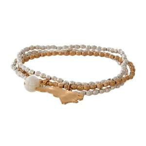 Two tone stretch bracelet with a state of North Carolina and freshwater pearl bead charm.