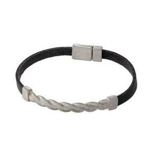 Black leather bracelet with a silver tone twisted metal focal and a magnetic closure.