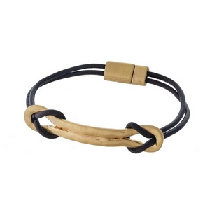 Brown leather bracelet with a gold tone bar focal and a magnetic closure.