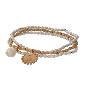 Two tone stretch bracelet with a block 'S' initial and freshwater pearl bead charm.