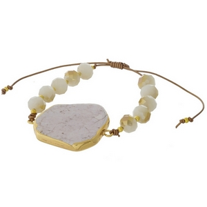 Ivory beaded pull-tie bracelet featuring a white marbled natural stone focal. Handmade in the USA.