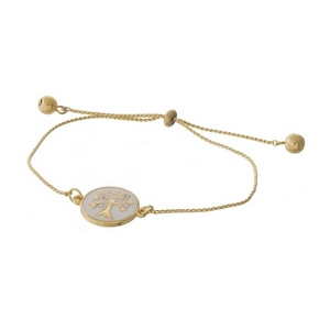"Dainty gold tone pull-tie bracelet with a tree on one side and the other side is stamped with ""Family is forever."""