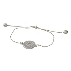 """Dainty silver tone pull-tie bracelet with a heart on one side and the other side is stamped with """"I'll always love you."""""""
