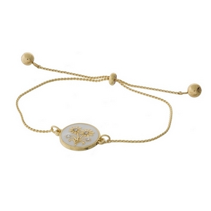 "Dainty gold tone pull-tie bracelet with flowers on one side and the other side is stamped with ""Love you bunches."""