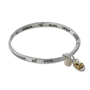 "Silver tone bangle bracelet stamped with ""Mother of mine, bright star in my life, because of you I know what love is, when to hug and how to shop."""
