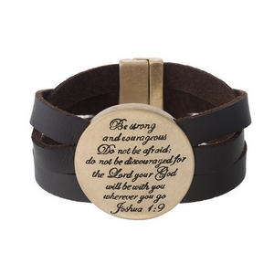 "Brown faux leather magnetic bracelet featuring a gold tone circle stamped with ""Be strong and courageous. Do not be afraid; do not be discouraged for the Lord your God will be with you wherever you go."""