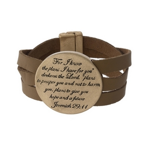 "Tan faux leather magnetic bracelet featuring a gold tone circle stamped with ""For I know the plans I have for you, declares the Lord. Plans to prosper you and not to harm you, plans to give you hope and a future."""