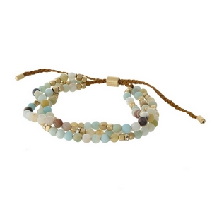 Brown cord, pull-tie bracelet featuring three rows of amazonite natural stone beads.