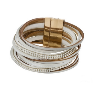 White, faux leather magnetic bracelet with clear rhinestone accents.