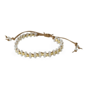 Tan cord, pull-tie bracelet featuring braided white faceted beads. Handmade in the USA.