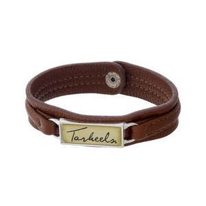 """Officially licensed, University of North Carolina brown faux leather snap bracelet with a silver tone bar saying """"Tarheels."""""""