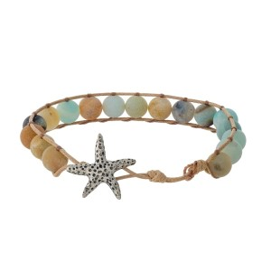 Tan cord bracelet featuring amazonite natural stone beads and a silver tone starfish toggle closure.
