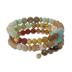 Amazonite, mint green, topaz and brown beaded coil bracelet with gold tone accents.