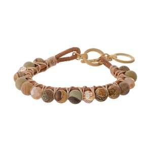 Brown leather toggle bracelet featuring wrapped picture jasper natural stone beads and gold tone accents.