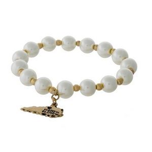 Gold tone and pearl beaded stretch bracelet with a state of Kentucky charm.