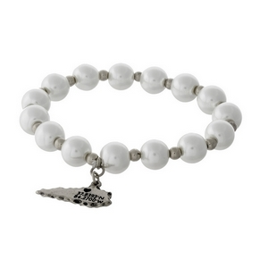 Silver tone and pearl beaded stretch bracelet with a state of Kentucky charm.