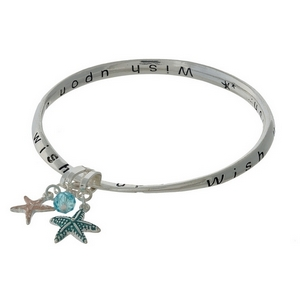 "Silver tone bangle bracelet stamped with ""Wish upon a starfish."""