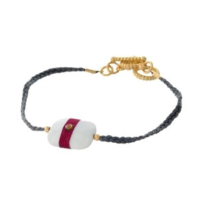 Gray braided cord toggle bracelet with a white stone focal and gold tone accents.