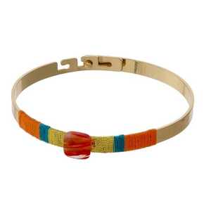 Gold tone bangle bracelet with orange and teal thread wrapping details.