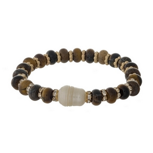 Brown semi-precious stone stretch bracelet with a freshwater pearl bead accent.