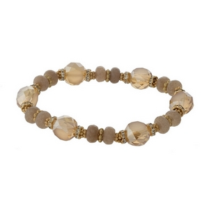 Topaz and gold tone beaded stretch bracelet with clear rhinestone accents.