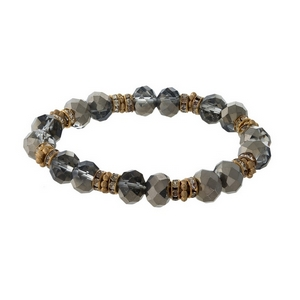 Hematite and gold tone beaded stretch bracelet with clear rhinestone accents.