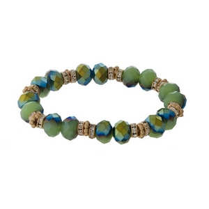 Green and gold tone beaded stretch bracelet with clear rhinestone accents.