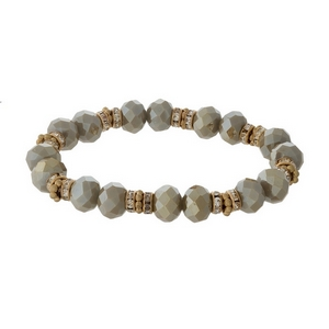 Taupe and gold tone beaded stretch bracelet with clear rhinestone accents.