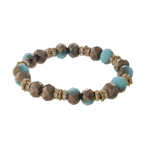 Turquoise and gold tone beaded stretch bracelet with clear rhinestone accents.