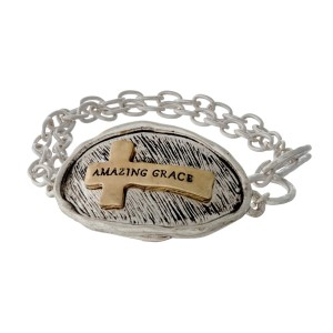 "Silver tone toggle bracelet stamped with ""Amazing Grace"" on a two tone cross."