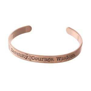 "Rose gold tone cuff bracelet stamped with ""Serenity. Courage. Wisdom."""
