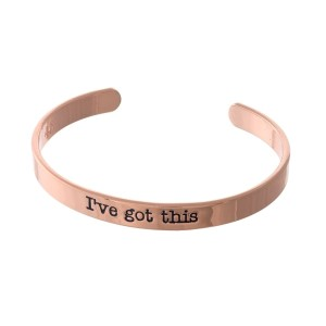 "Rose gold tone cuff bracelet stamped with ""I've got this."""